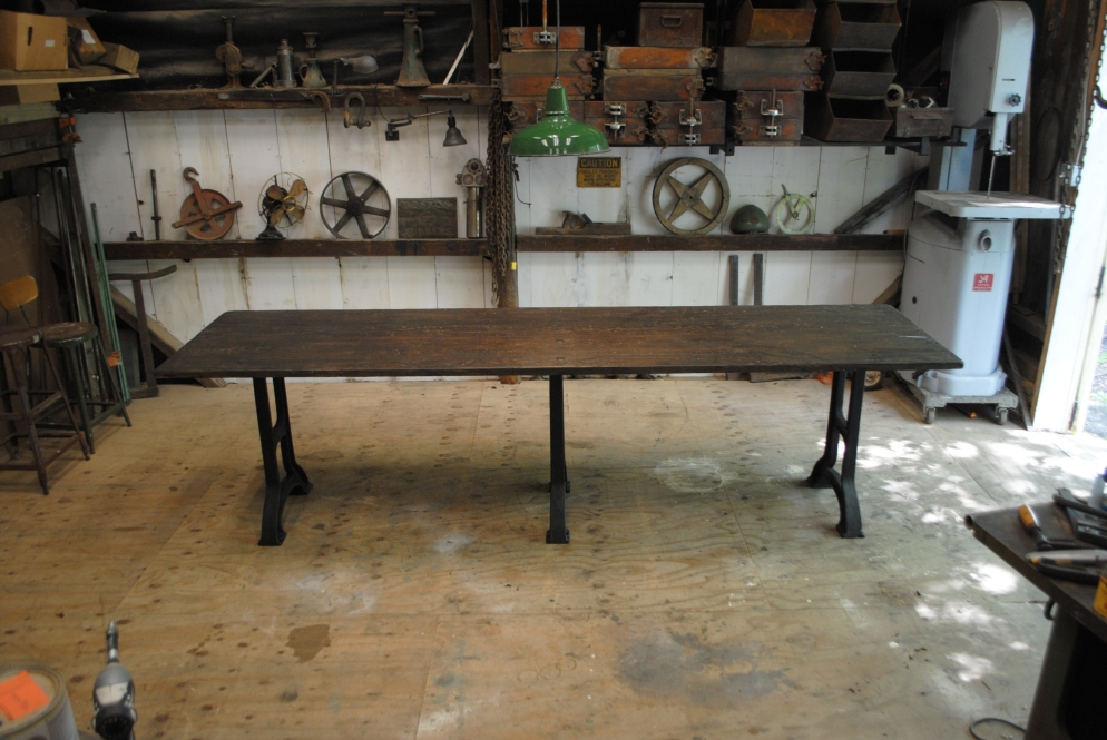 10' long dining room table. Top is an antique workbench, and sits on 1920's cast iron legs.