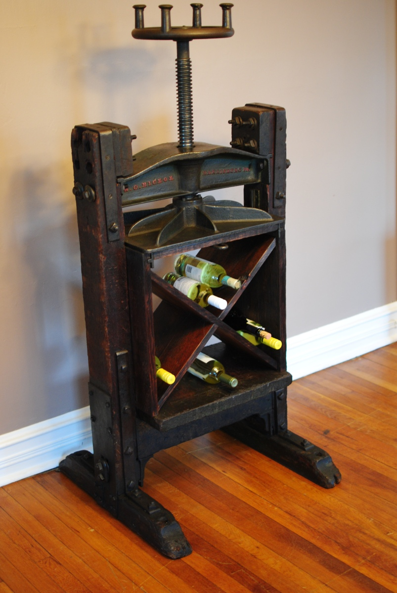 Big Red Storage >> An 1860's Book Press repurposed into wine/bar storage and display.