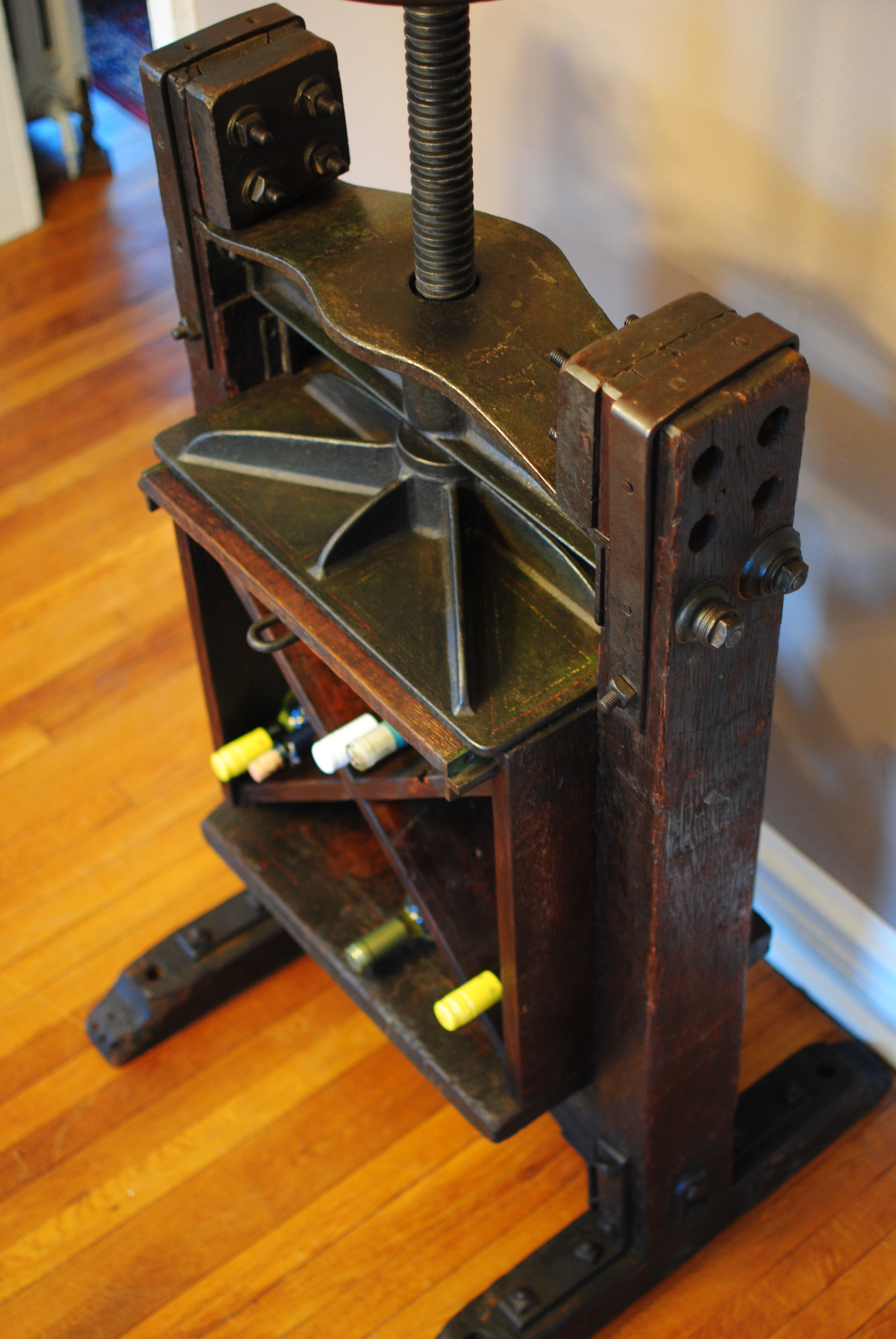 An 1860 S Book Press Repurposed Into Wine Bar Storage And