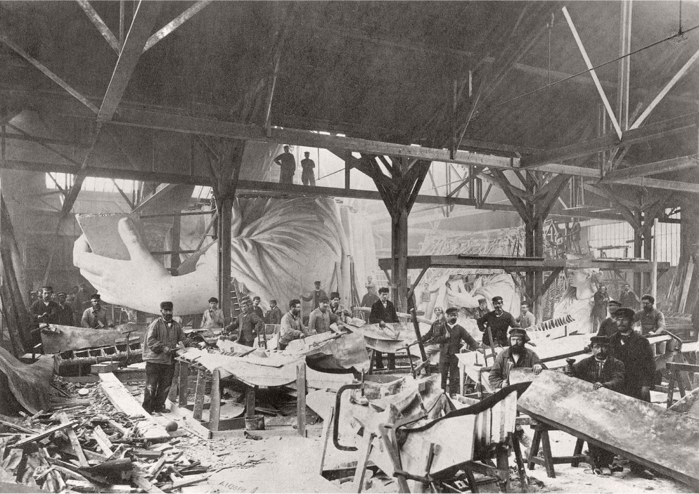 French metalworkers building a tiny statue for New York....